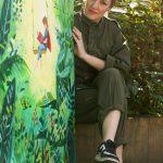 LHL_2020_012a: photograph of Angela sat holding the artwork, 'Love', © Angela Lock, 2020 Thumbnail