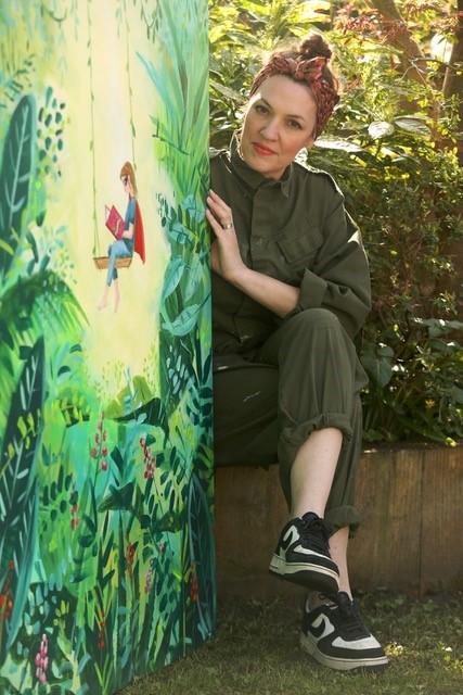 LHL_2020_012a: photograph of Angela sat holding the artwork, 'Love', © Angela Lock, 2020