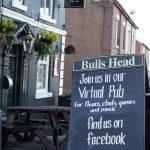 LHL_2020_014g - A chalk board sign outside the closed Bulls Head pub in High Lane invites people to their virtual pub via Facebook. Thumbnail