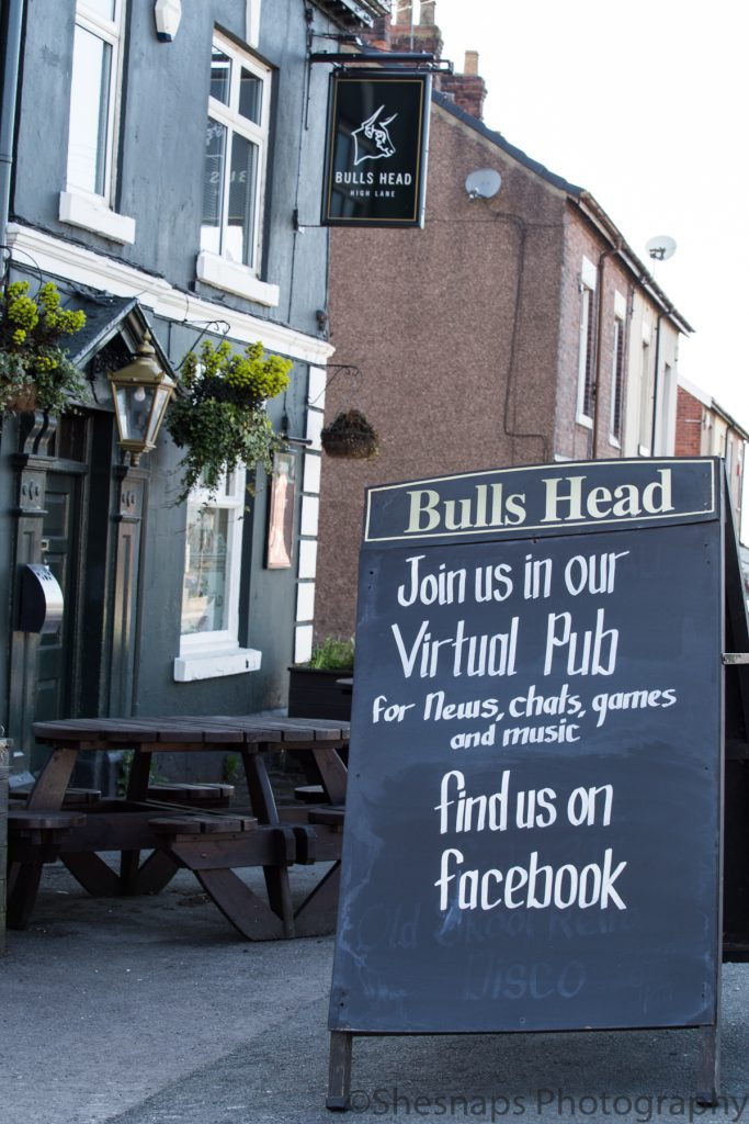 LHL_2020_014g - A chalk board sign outside the closed Bulls Head pub in High Lane invites people to their virtual pub via Facebook.