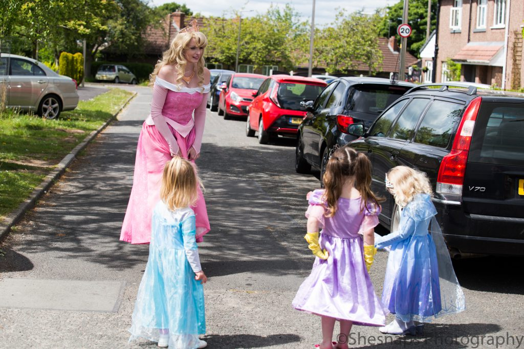 LHL_2020_014hi – A visit from a Princess; three young children are visited by someone dressed as Princess Aurora from Disney's version of Sleeping Beauty. Dressing up in costume became a theme for Stockport – with the Stockport Spidermen and others following suit, using the daily allowance of exercise to cheer people up on the way around.