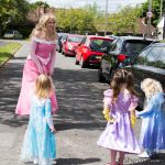 LHL_2020_014hi – A visit from a Princess; three young children are visited by someone dressed as Princess Aurora from Disney's version of Sleeping Beauty. Dressing up in costume became a theme for Stockport – with the Stockport Spidermen and others following suit, using the daily allowance of exercise to cheer people up on the way around. Thumbnail