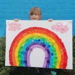 LHL_2020_021a: Photograph of Isla holding a large rainbow sign which she made. Thumbnail