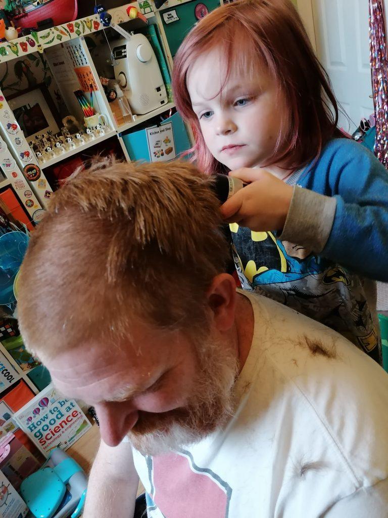 LHL_2020_021b: Photograph of Isla shaving hair