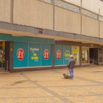 TOPM_2020_418g: photograph of a person and a dog in Merseyway, looking at Poundland, taken by Jake Bowden.  Thumbnail