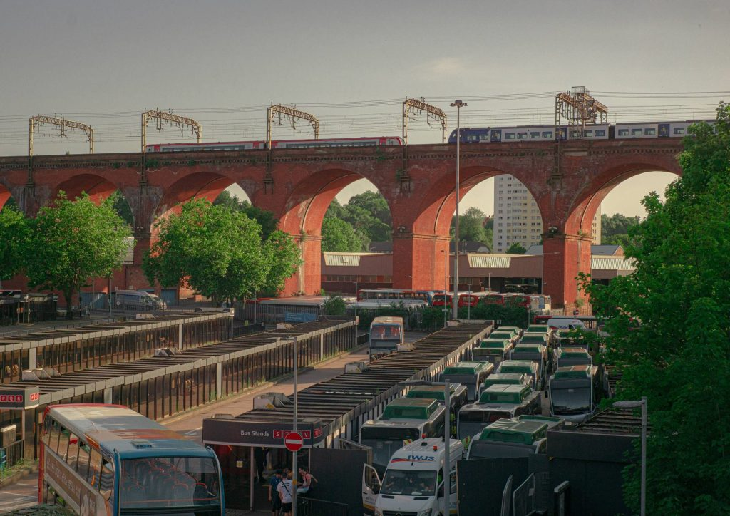 STOPM_2020_418g: Photograph of a train going over the Stockport Viaduct, with Stockport bus station below, taken by Jake Bowden.