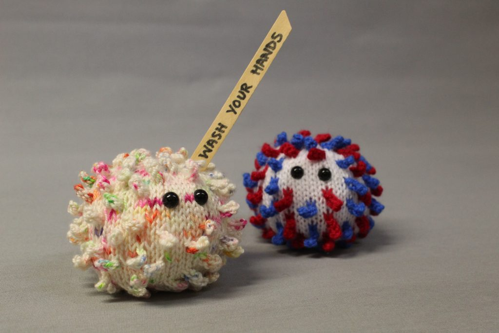 STOPM_2020_453b: both the knitted VE coronavirus and the 'Wash Your Hands' knitted coronavirus together in a photograph.