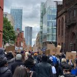 STOPM_2020_455_456b: photograph showing a large number of people in a protest march, in Manchester. The people in front are holding home made signs, which are plain on the back. The march was in Manchester on Saturday 6th June 2020.  Thumbnail