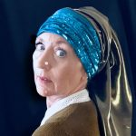 STOPM_2020_545a: self-timer photograph of Valerie, looking over the shoulder with a pearl on her nose and scarves of blue sequins and grey silk draped around her head [in the style of the painting The Girl with a Pearl Earring by Johannes Vermeer]. Thumbnail