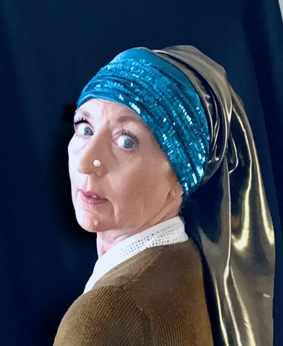 STOPM_2020_545a: self-timer photograph of Valerie, looking over the shoulder with a pearl on her nose and scarves of blue sequins and grey silk draped around her head [in the style of the painting The Girl with a Pearl Earring by Johannes Vermeer].